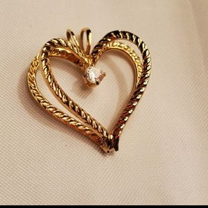 Show love w/this gold plated heart & cz pe…